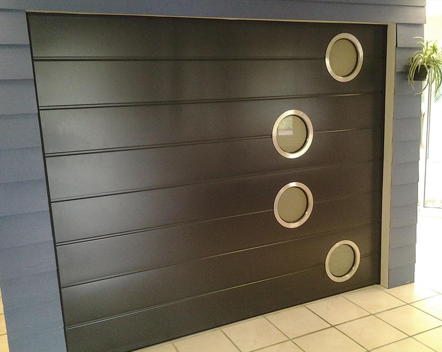 Pose de porte de garage autour de quimper audierne for Poseur de porte de garage sectionnelle